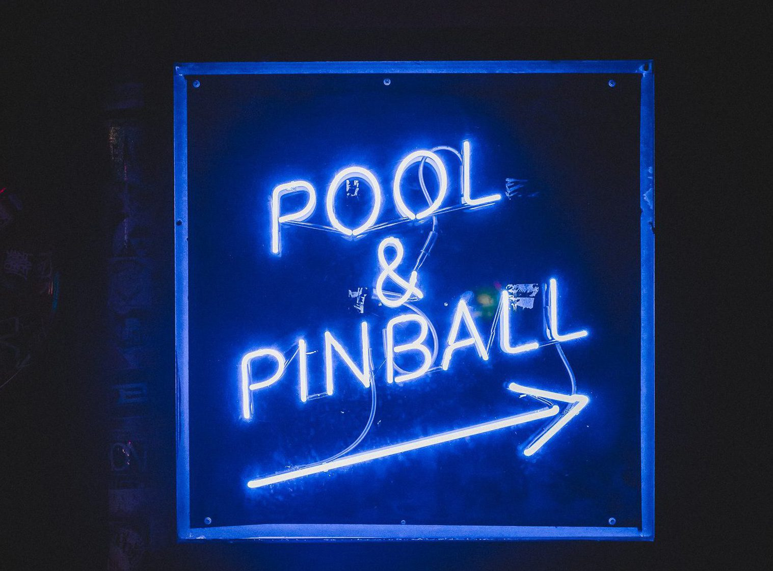 "Blue neon sign that reads ""pool and pinball."""